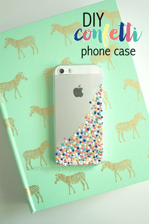 A DIY phone case decorated with nail polish.