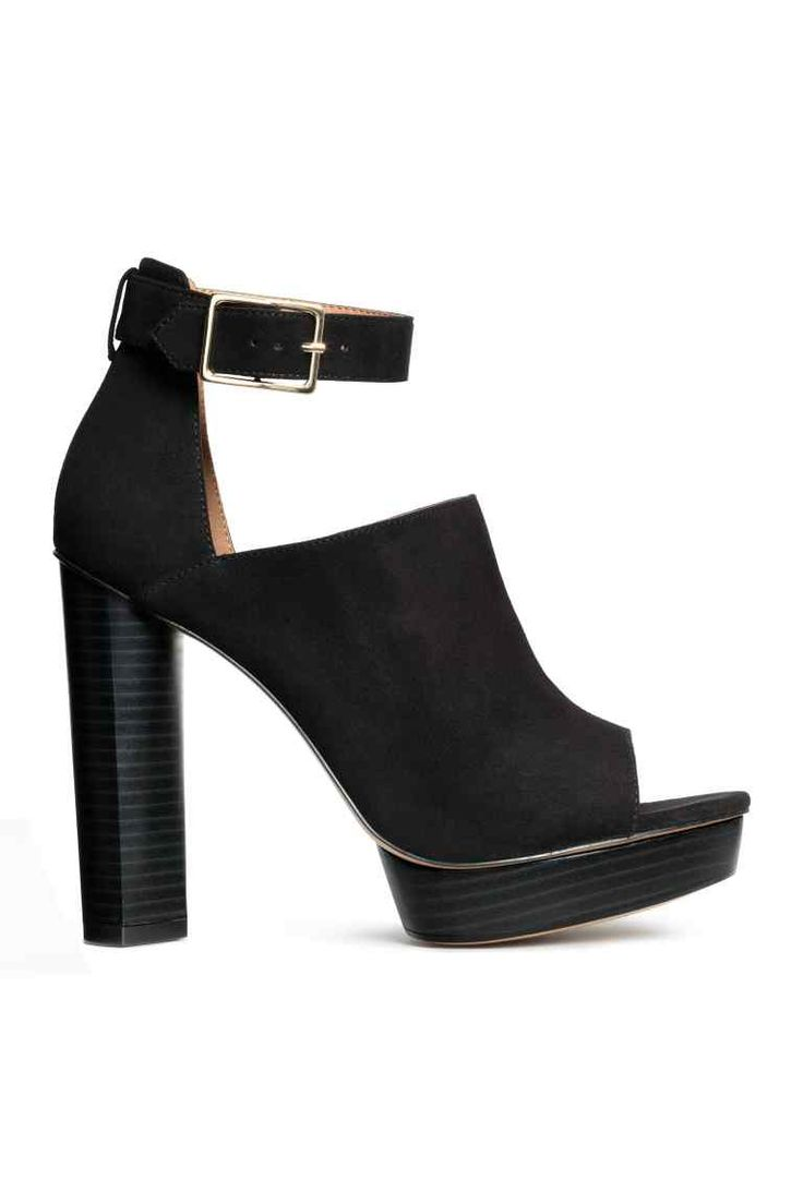 Platform boots: Platform peep-toe boots in imitation suede with an ankle strap and adjustable metal buckle, imitation leather linings and insoles and rubber soles. Platform front 2.5 cm, heel 12.5 cm.