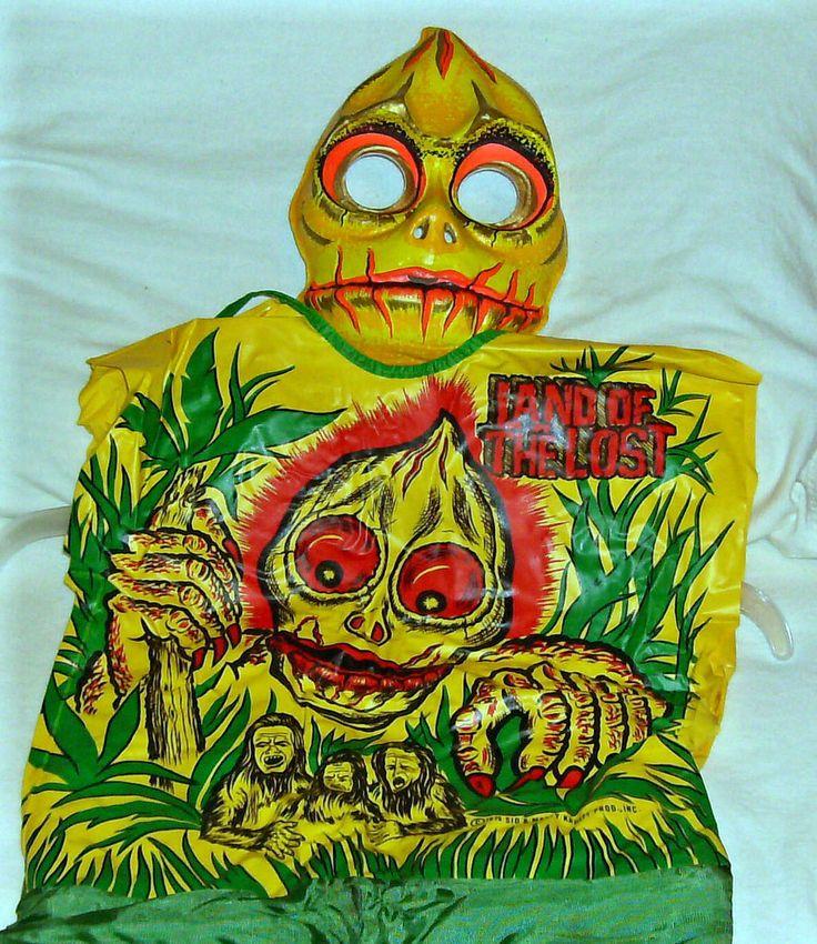 Vintage Land of the Lost Sleestack Halloween costume by Ben Cooper, circa 1970s.