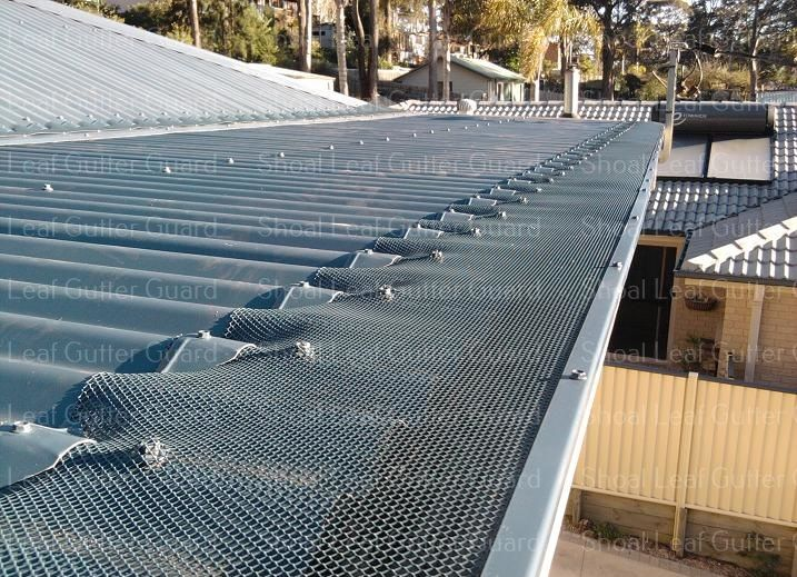 Deep Ocean Blue Roof With Leaf Stopper Gutter Guard Leaf Guard Basin View Gutter Guard Basin View Architecture Details Roof Architecture Leaf Guard