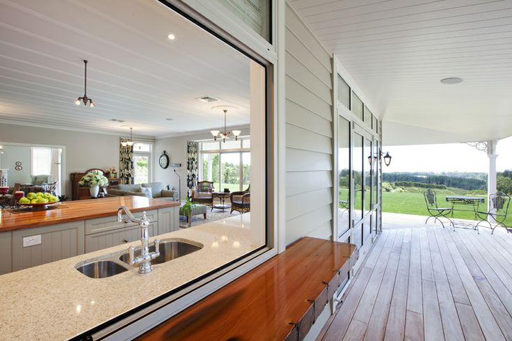 The site caters perfectly to this home's spacious sprawl - the wide verandah with its mahogany decking stretching the width of the house before wrapping into a sheltered outdoor entertainment area. This includes kitchen bar-serving and bi-fold door access off family living.