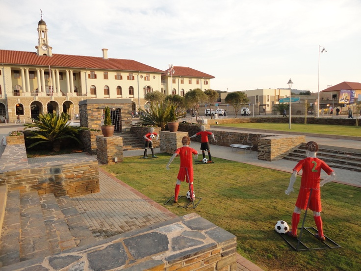 """2010 - Pretoria Station Historical Forecourt restoration @ Pretoria Main Station and Gautrain station - View from historical sunken garden towards the Station Building.  """"Soccer Men"""" installed by the World cup 2010 team."""