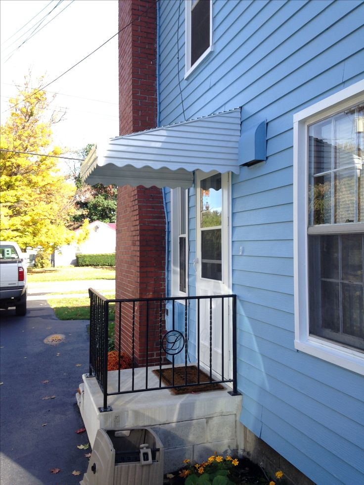 White aluminum door awning. Prevent snow and ice on your steps this winter. #aluminumawning www.jamestownawning.com