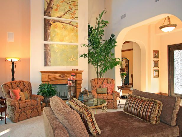 The 18 foot high ceilings demand large scale furniture - Family room wall decor ideas ...