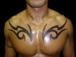 Image result for tribal patterned chest tattoos for men