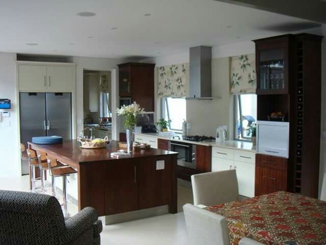 Modern/Contemporary Kitchen with a mix of wood and duco cabinetry