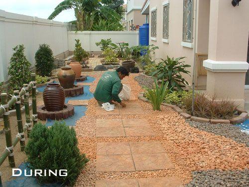 Forget grass why not install a pebble rock garden for Garden ideas no grass
