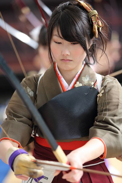 Asian people Kyudo girl Japan Sanju-sangen-do Temple, Higashiyama, Kyoto.