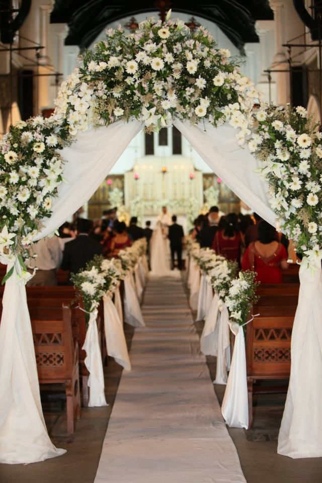 english church wedding decorations | like the pew decorations: fabric coming down from bouquet
