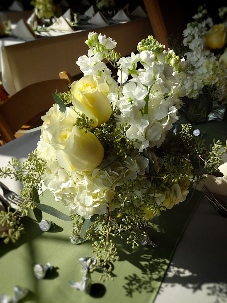 Rustic Barn Wedding - Fall Wedding - Hydrangea, Roses, and Eucalyptus Centerpieces with Mercury Glass Votives | Baumann's Florist