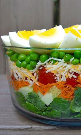 Not only is this a healthy dish that looks great, it's easy to make and works well at a picnic or family get together. 7 Layer Salad recipe from @scarletp. Try it for Meatless Monday!
