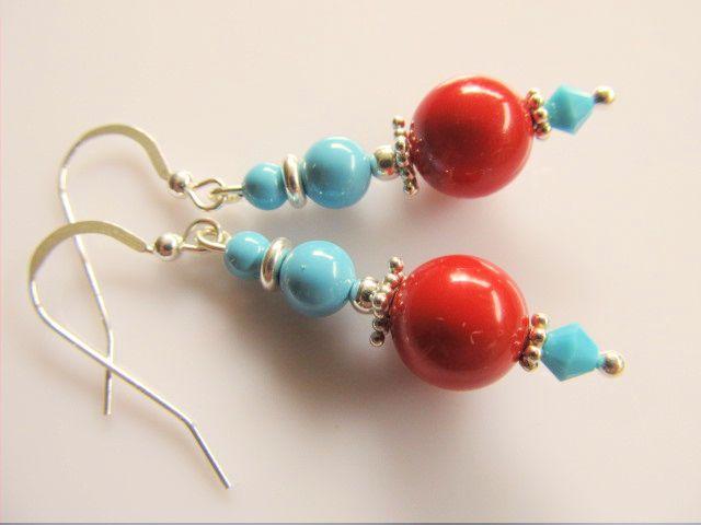 Oorbellen Coral Blue red Coral en turquoise swarovski parels met turquoise swarovski kristal kraaltje. geheel zilver. www.doloressieraden.nl