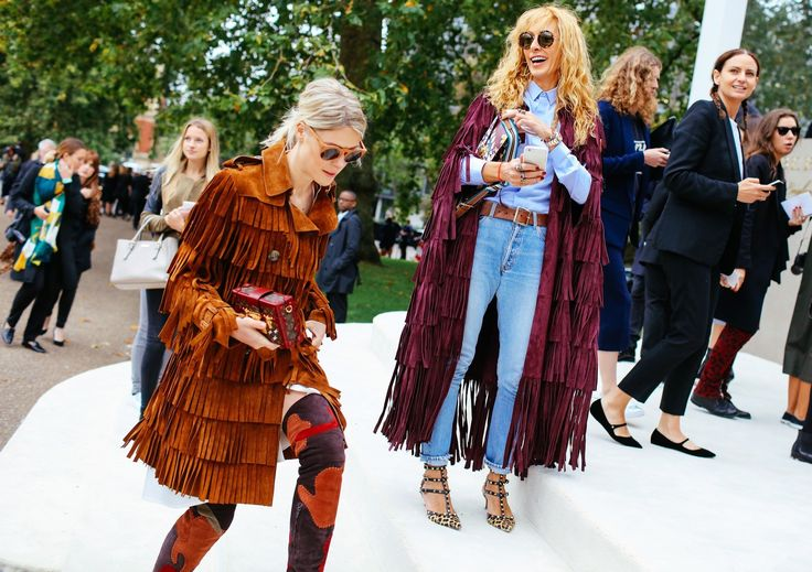 Sofie Valkiers in a Burberry Prorsum coat and boots with a Louis Vuitton bag, and Elina Halimi in a Burberry Prorsum coat