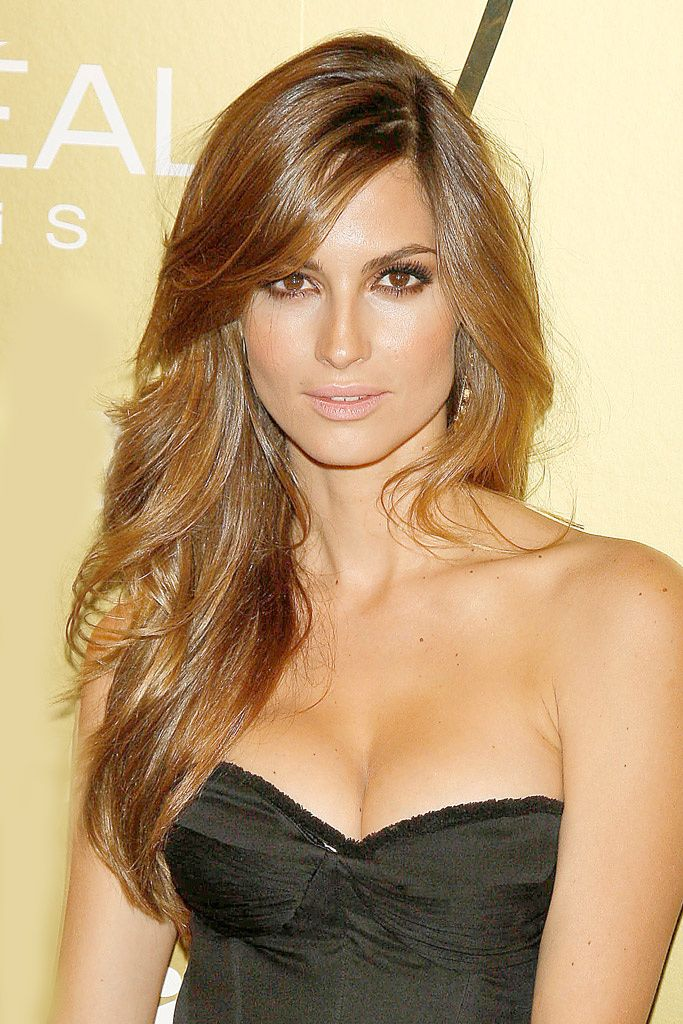 Caramel brunette, Ariadne Artiles. Deep side part with bangs slightly across face is so pretty.
