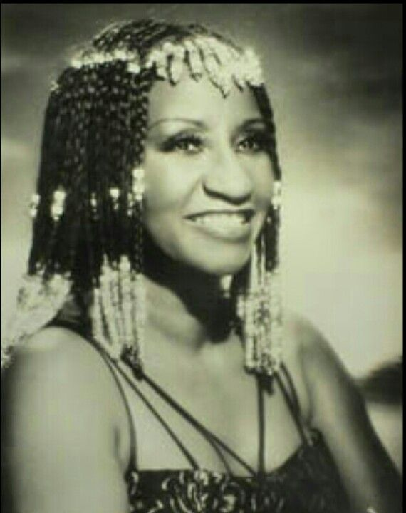 Celia Cruz the salsa queen. This Afro-Cuban was a diva! She was the only Afro-Latina I knew while growing up and she embraced her curvy body, while she had everybody dancing their asses off!
