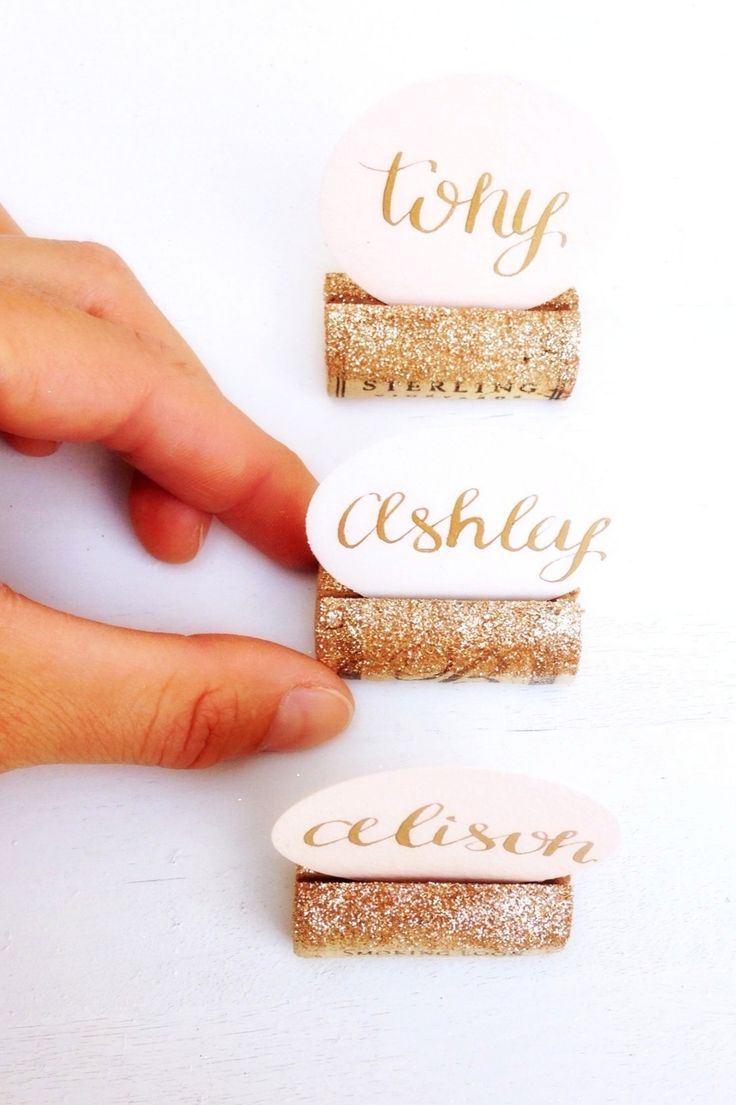 Gold Glitter & wine corks for the win! What a unique way to display guest place cards at your wedding reception or bridal shower. Discover more sparkly wedding décor at www.karasvineyardweddingshop.com Cheers!
