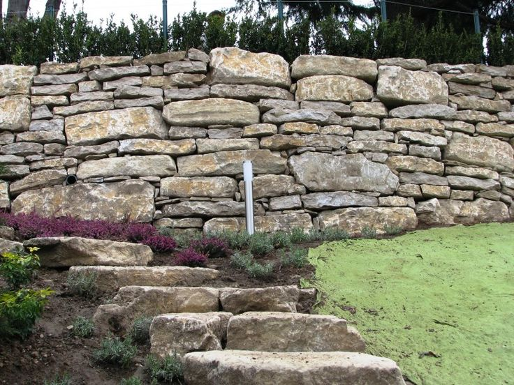 Oltre 25 fantastiche idee su giardino di ghiaia su - Muretti in pietra giardino ...