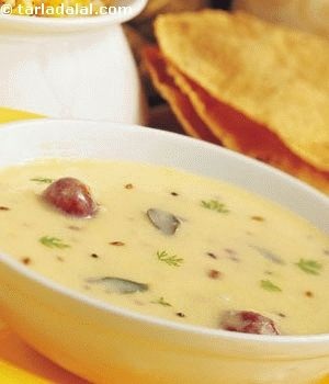 Kadhi is a traditional gujarati preparation of a wonderful sweet and spicy curd mixture thickened with gram flour, which can be enhanced in many ways using other ingredients like pakoras and koftas. Remember never to boil the kadhi on a high flame as it tends to curdle. Gujarati kadhi goes very well with khichdi.