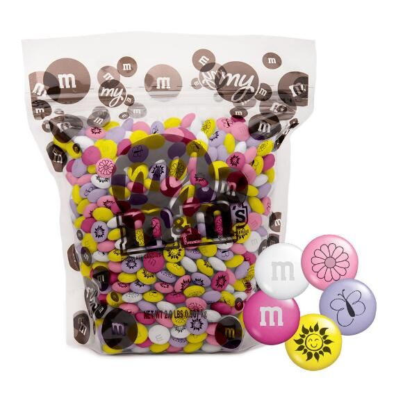 Spring M&M'S®️️ Candy - The best way to celebrate Easter? Candy, of course! Brighten up the year's sweetest season with a fun blend of bright, blossoming pinks, purples, and yellows decorated with sunshine, butterflies and flowers.