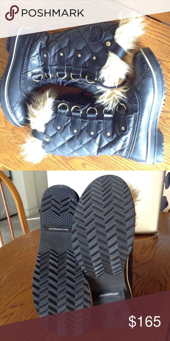 Sorel snow boots-  water proof 💦❄️ NEW Never worn.  The fur is still furry.  Sz. 6 Black/tan/gold. Limited edition, from Sundance film fest gifting suite a few years ago. Sorel Shoes Winter & Rain Boots
