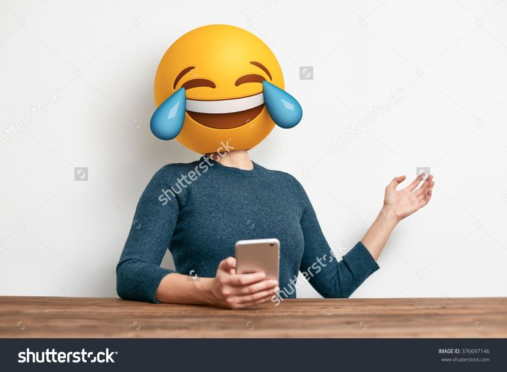 Emoji Head Woman Sitting At The Desk. Woman Wearing Tears Of Joy Emoji Masks While Looking At Her Phone. This Emoji Is Laughing So Much That It Is Crying Tears Of Joy Stock Photo 376697146 : Shutterstock