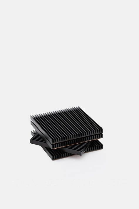 Designer Shaun Kasperbauer, co-founder of Brooklyn-based Souda, refines a traditional tabletop accessory to its architectural essence with this set of four coasters. The slim, ribbed squares of anodized aluminum are produced through a unique partnership with a manufacturer of industrial heat sinks. Each cork-backed coaster is the result of a common yet complex manufacturing technique reimagined so as to combine the industrial and the domestic.