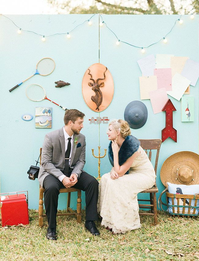 A unique backyard DIY wedding with wall vignettes by the bride and groom!