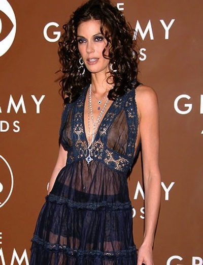 Teri Hatcher  Terri just grabbed an apron off of the set of Desperate Housewives for her 2006 Grammy's dress.  Read more at http://styleblazer.com/72795/19-outrageous-red-carpet-outfits-sultry-or-just-trashy/#9WtcbeSEHaYC74ZB.99