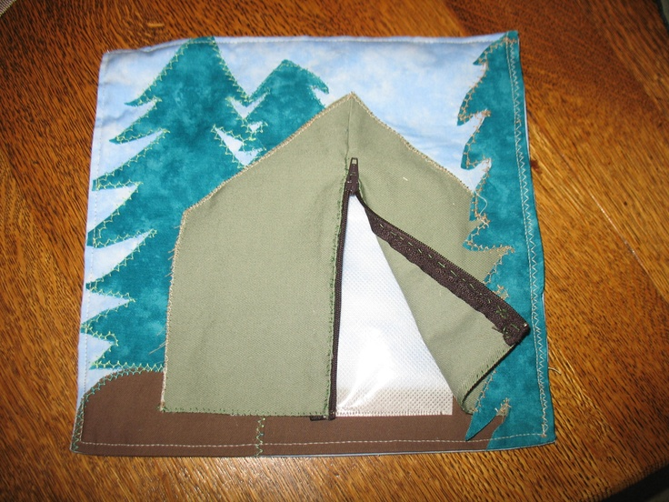 This was one of the more time consuming pages, as it's layered and required actual planning in the sewing.  Family pictures can be inserted into the plastic pocket inside the tent adding surprise to the zipping.