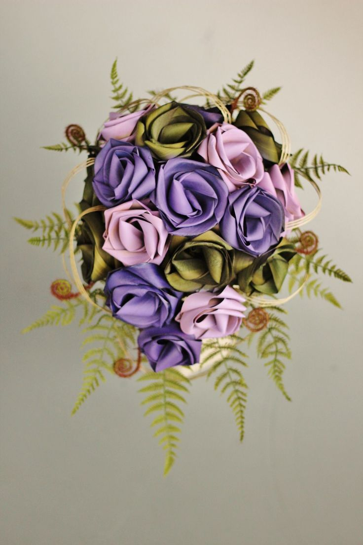 Teardrop flax brides bouquet in mid purple, lavender & sage, with koru & fern. www.flaxation@xtra.co.nz