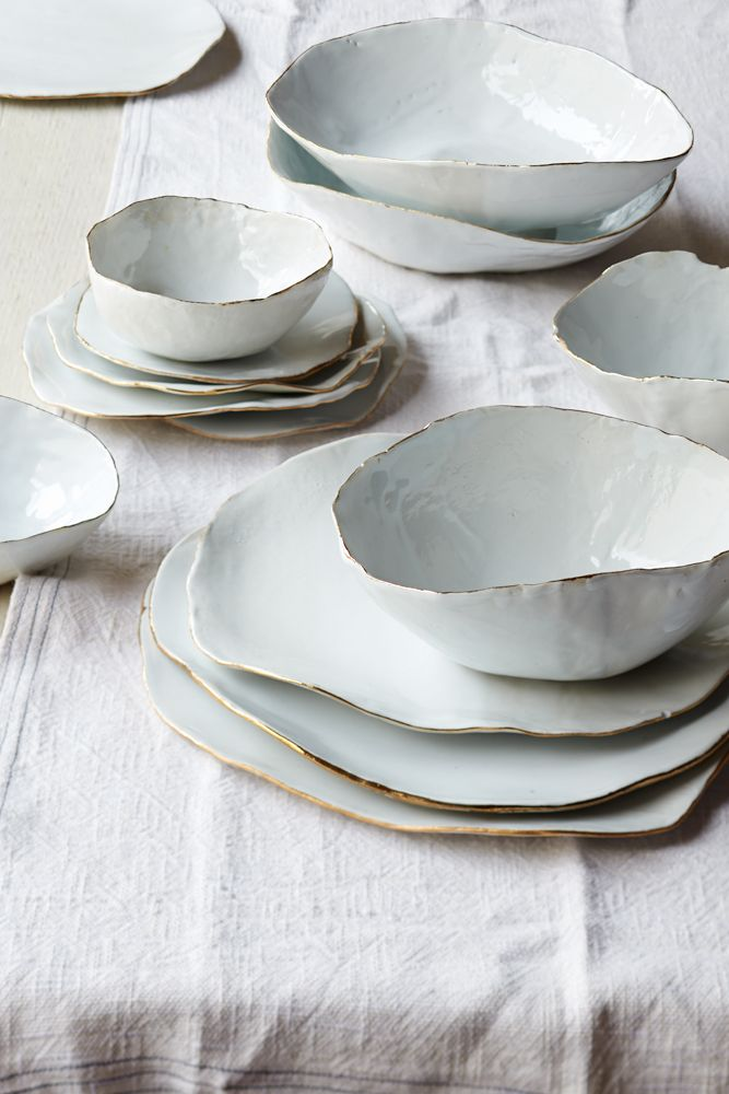 Ceramic bowls & plates with gold rims. By Laura Letinsky.
