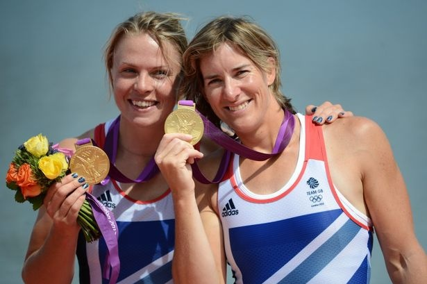 Anna Watkins and Katherine Grainger on podium after receiving their gold medals.