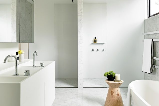 In the bathrooms, a limited palette of materials folds up the walls and into shelves.