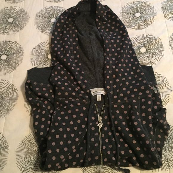 Victoria secret polka dot zip up hoodie size M Dark gray zip up hoodie from Victoria Secret. Polka dots are a orangey-pink color. It's a thin hoodie with really soft lining. The hoodie is on the shorter side (hits waist) with dolman sleeves. Great condition. Victoria's Secret Tops Sweatshirts & Hoodies