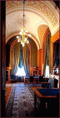 Kremlin. Empress's study. The rooms are brought to life by breathtaking chandeliers gilded with gold with multi tiered garlands of crystal pendants. The floors are covered with carefully selected patterned carpets