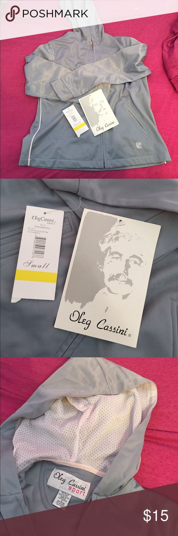 NWT Oleg Cassini track suit Brand new with tags, jacket and pants are both fleece lined, pants have zippers on bottom, in perfect condition! *ALL ITEMS IRONED PRIOR TO SHIPMENT!* Oleg Cassini Sport Other