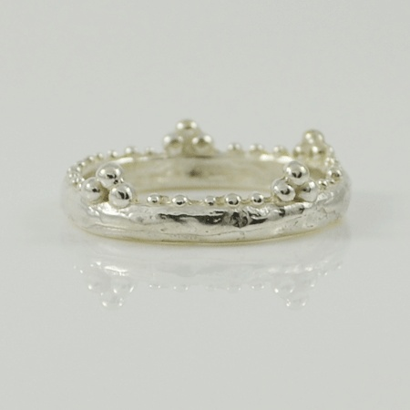 This ring brings back childhood memories of dress ups with tiaras, mum's shoes, pink dresses and fluffy feathers! The Princess Tiara ring from Amery Carriére's collection encapsulates that in a modern whimsical way.    Get it now at http://www.crowdedsilver.com.au/store/princess-tiara-ring-p-21187.html