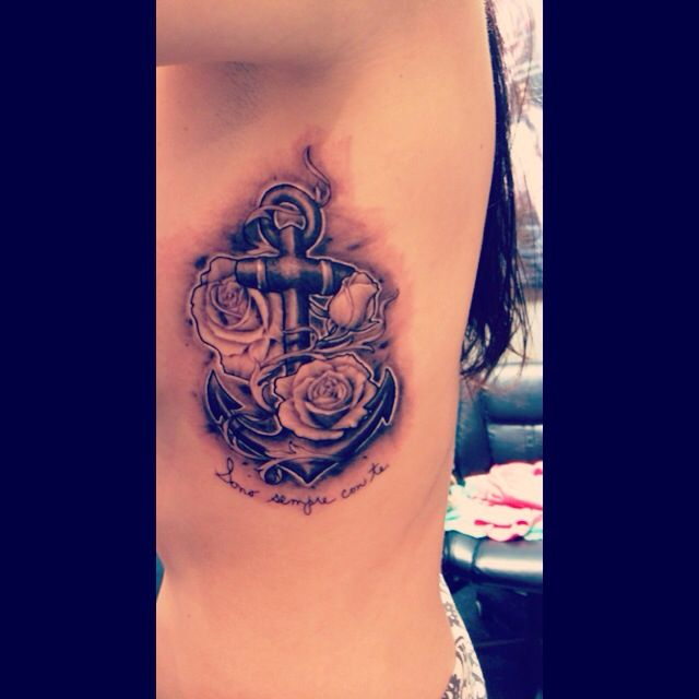 Anchor and rose side tattoo