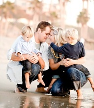 great pose with parents touching    beach family portrait