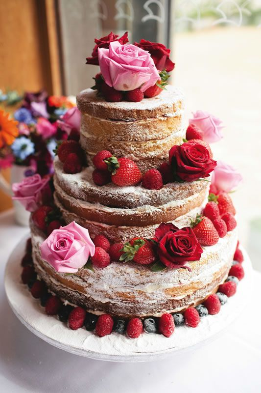 Lovely victoria sponge naked wedding cake. A real life wedding with Esme and Mike at the famous River Cottage