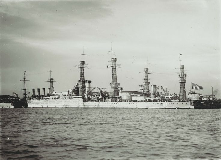Port broadside view of the Nevada (BB-36) moored at Melbourne, as part of the cruise of the Battle Fleet to Australia and New Zealand in 1925. The Nevada is moored aft of the Oklahoma (BB-37). Left to right, the Seattle (CA-11) and Pennsylvania (BB-38) are moored on the far side of the wharf. The ships are visiting Melbourne as part of the cruise of the Battle Fleet to Australia and New Zealand in 1925.Source: State Library Victoria, Photo No. H91.325/409 courtesy of Mike Green.