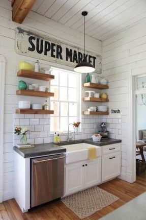 open shelving, farmhouse sink, subway tile, wood, white palette, simple decor, pops of color // farmhouse kitchen by Magnolia Homes