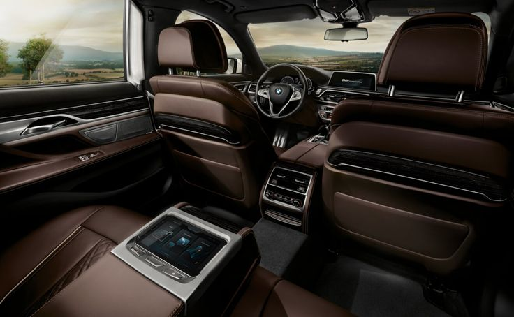 BMW 7 Series Sedan  The BMW 750i xDrive interior in exclusive Mocca Nappa leather and Fineline Black wood trim with Metal effect, available the M Sport package.