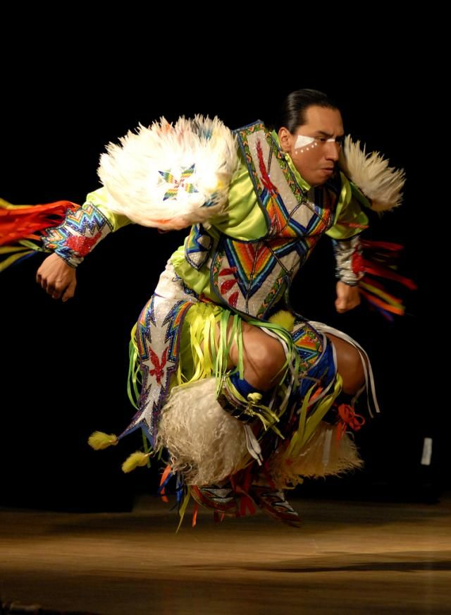 Larry Yazzie, with Native Pride Productions, entertains guests through tribal dance in celebration of Native American Heritage Month.