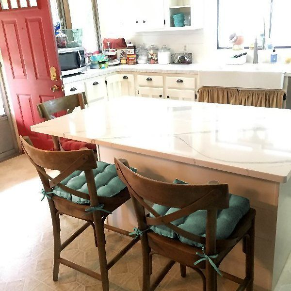 """""""I bought Hayden Turquoise Dining Chair Pads for our island chairs. They fit our chairs great and I love how they look! The cushions are high quality! They are still comfortable and have stayed tied and do not move around. I'm very happy with these. So happy I purchased more in red for our kitchen chairs!"""" -Julie G. #customerfeedback #testimonials #turquoise #kitchen #barstool #dining #gallery #diningroom #homedecor #BarnettHomeDecor #aqua #chairpad"""