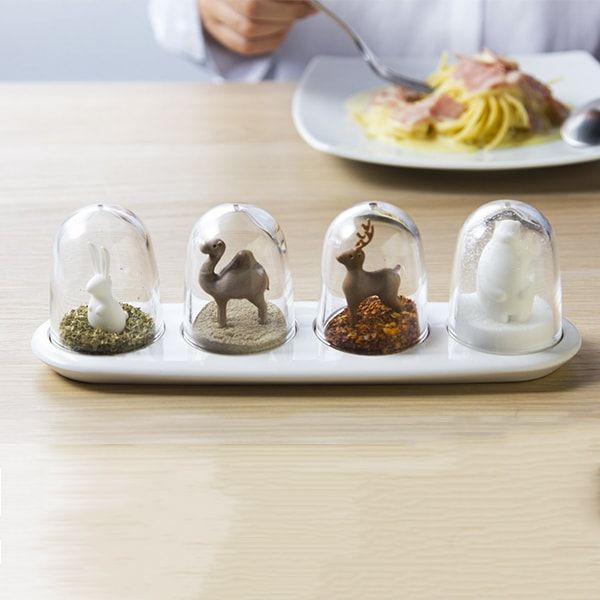 Celebrate the seasons with a little bit of seasoning or proudly display your penchant for polar bears and gourmet salt. Each cruet set displays 4 trees or 4 animals that stay hidden until your seasonings run low. Buy one for yourself and one for a friend!  <ul><li> Refillable shakers mount on a glossy white spice cruet </li> <li> Clear dispensers contain tree or animal figures </li> <li> Each spice or herb containers has a removable bottom for ea...