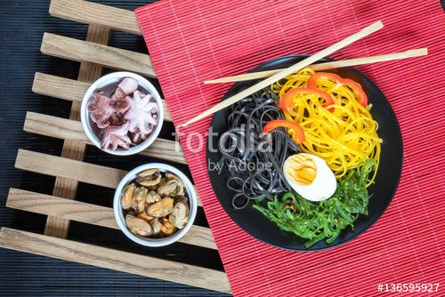"Download the royalty-free photo ""Hiyashi wakame with sesame and nut sauce, black and corn noodles, boiled egg. Octopus and mussels in ceramic bowls. The rustic wooden lattice, black and red makisu"" created by Victoria Kondysenko at the lowest price on Fotolia.com. Browse our cheap image bank online to find the perfect stock photo for your marketing projects!"