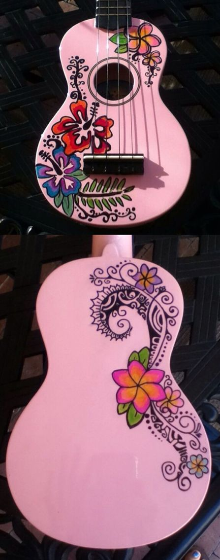 Pink Ukulele with sharpies Polynesian design and flowers.