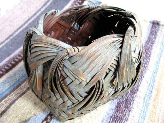 This handsome little basket was made in China out of bamboo. It measures 4  high by 6 long by 5 wide and features an intricate weaving pattern. Its