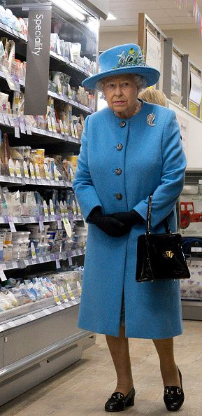 Britain's Queen Elizabeth II looks around a Waitrose supermarket during a visit to the town of Poundbury, southwest England, on October 27, 2016.
